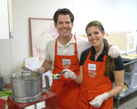 Couple cooking together in cooking class.