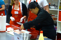 Sushi Cooking Class - Teacher Helping Students